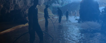 Rescuers holding rope to help divers come back