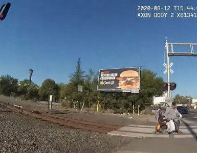 Police Officer Saves Man From Train